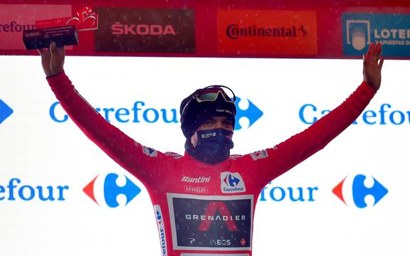 The new overall leader Team Ineos rider Ecuador's Richard Carapaz celebrates on the podium after the 6th stage of the 2020 La Vuelta cycling tour of Spain.