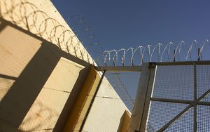 prison bars and barbed wire