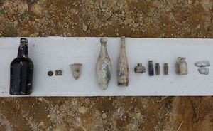 Artefacts found include ink wells and beer bottles.
