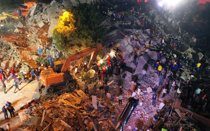 IZMIR, TURKEY - OCTOBER 30: A drone photo shows that search and rescue works continue at debris of a building in Bornova district after a magnitude 6.6 quake shook Turkey's Aegean Sea coast, in Izmir, Turkey on October 30, 2020.