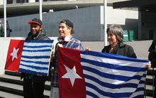 Green Party MP Catherine Delahunty (right) and others at a rally outside NZ's parliament calling for media freedom in West Papua.
