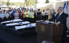 Israeli Prime Minister Benjamin Netanyahu (R) eulogizes at the funeral for the three Israeli teens.