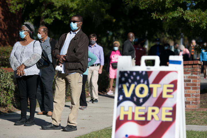 People stand in line outside to cast an early vote in South Carolina.