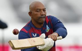 West Indies coach Phil Simmons gives his players catching practice during warm up on the second day of the first Test cricket match against England at the Ageas Bowl in Southampton on July 9, 2020.
