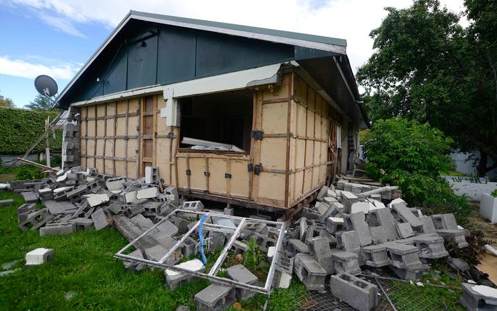 Damage to a house is seen in Waiau town, some 80 kms to the south of Kaikoura, on November 16, 2016, after an earthquake hit New Zealand on Monday.