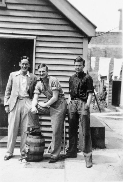 Ian Frank George Milner, Denis Glover and Robert William Lowry outside St Elmo flats, Christchurch.