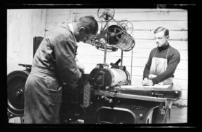 Denis Glover and John Drew at Caxton Press in 1934 shot by Jean Bertram