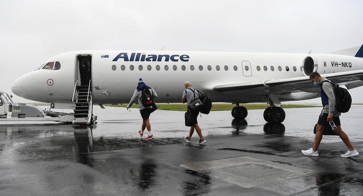 Warriors players leave on a charter flight to travel to the Australian city of Tamworth in NSW after being granted a special exemption to prepare for a re-vamped NRL season.
