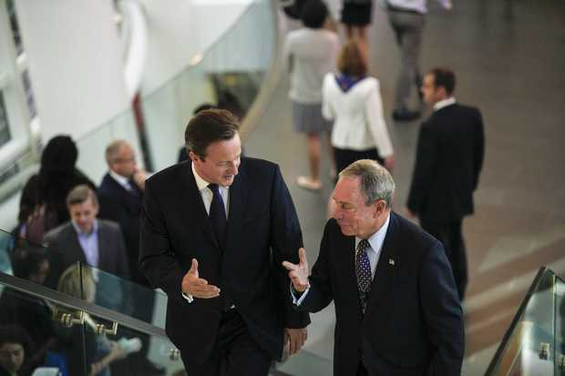 David Cameron shares a few words with Michael Bloomberg, founder of Bloomberg LP, at the company's headquarters in New York.