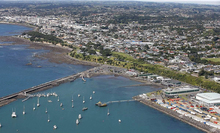 Aerial view of Port Taranaki breakwater area and New Plymouth beyond.