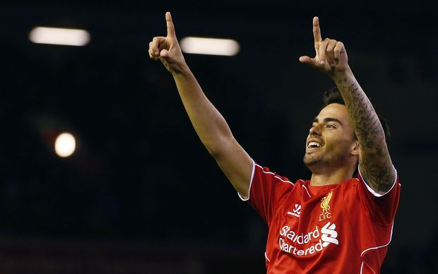 Liverpool's Suso celebrates after scoring during the League Cup soccer match against Middlesbrough.