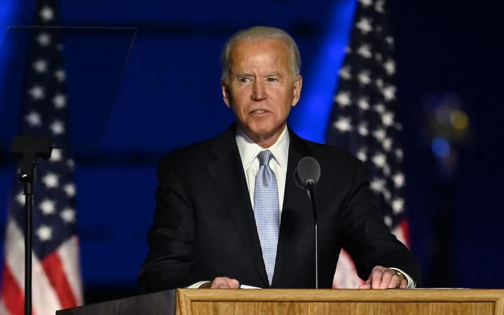 US President-elect Joe Biden delivers remarks in Wilmington, Delaware, on November 7, 2020, after being declared the winner of the presidential election. (Photo by Jim WATSON / AFP)