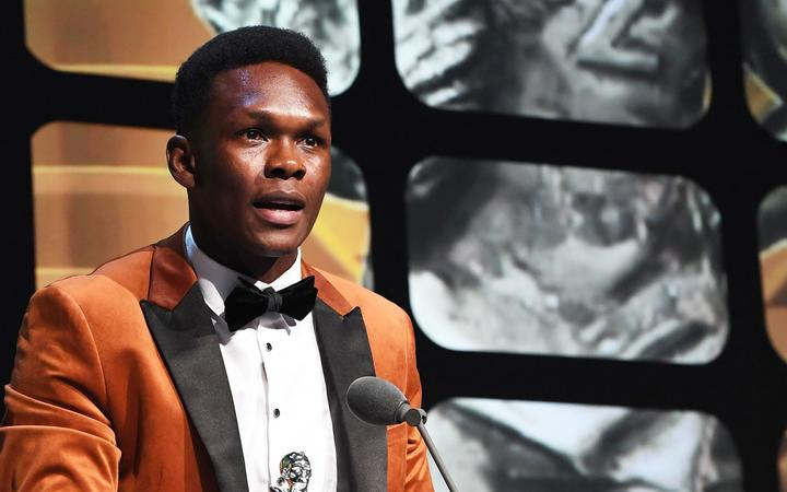 Israel Adesanya is set to spend Christmas in quarantine.