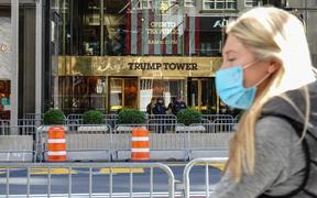 A person wearing mask walks past the Trump Tower. New York City continues Phase 4 of re-opening following restrictions imposed to slow the spread of coronavirus on October 17, 2020 in New York City.