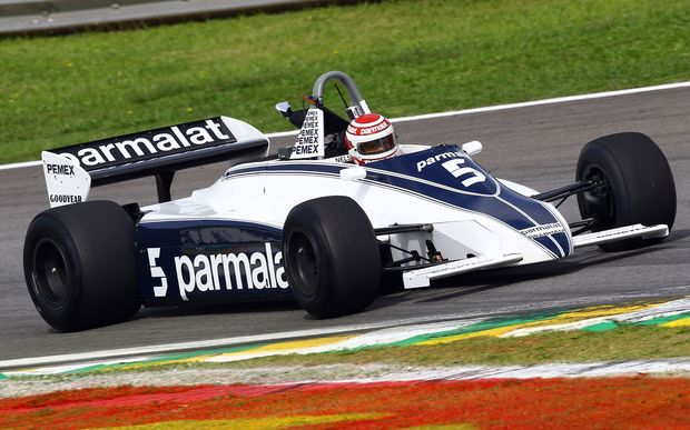 The Brazilian motor racing driver Nelson Piquet takes his 1981 championship winning Brabham BT49C on a demonstration lap at the 2011 Brazilian Grand Prix.