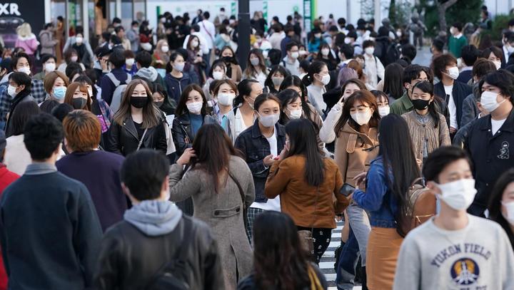 Many people wearing masks are seen at Shibuya scramble crossing in Tokyo on November 15, 2020.