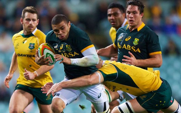 Bryan Habana of the Springboks is tackled by Scott Fardy of the Wallabies. September 2014.