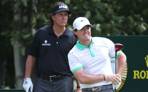 Rory McIlroy and Phil Mickelson on 9th hole during the first round of the 142nd British Open Championship. 2013.