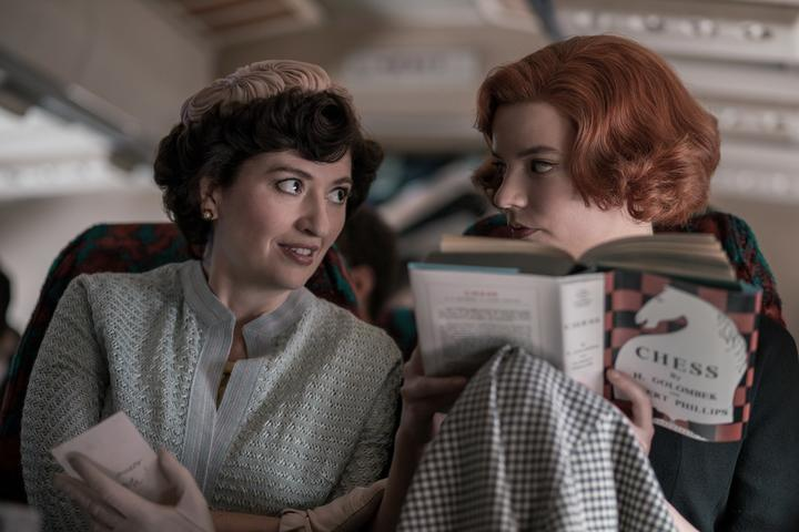 L-R: Alma Wheatley (Marielle Heller) is the adopted mother of orphan chess prodigy of Beth Harmon (Anya Taylor-Joy).