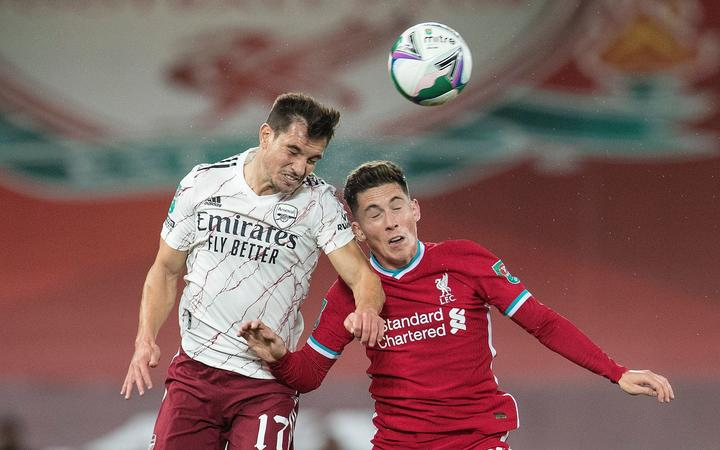Cedric Soares of Arsenal and Harry Wilson of Liverpool compete for a header