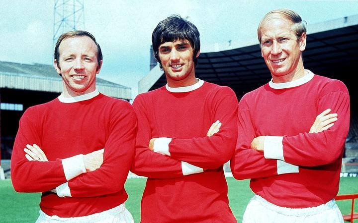 Nobby Stiles, George Best and Bobby Charlton of Manchester United pose for the cameras at Old Trafford in Manchester, England, 1968.