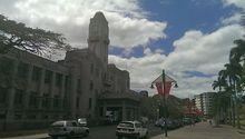 Fiji's refurbished parliament, a stone building with clock tower at entrance