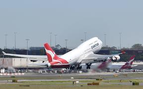 A Qantas Airways plane takes off at Sydney Airport in Sydney on March 19, 2020.