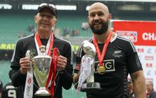 Coach Gordon Tietjens holds the IRB 7s World Series Trophy and DJ Forbes holds the London 7s Trophy after the match. 2014.
