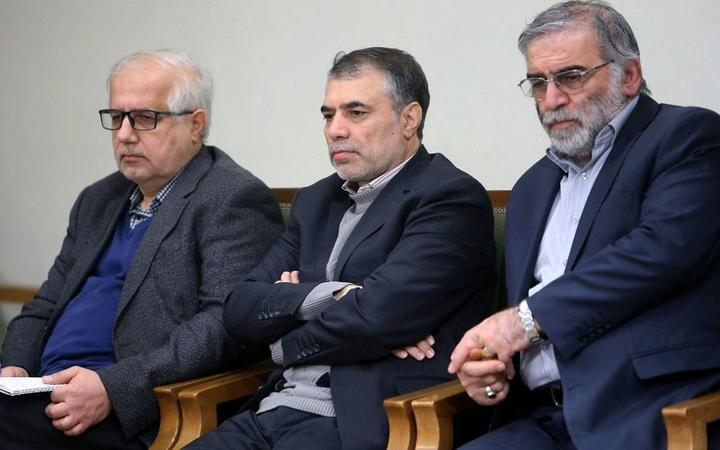 A handout picture provided by the Iranian Supreme Leader's official website on November 27, 2020, shows Iranian scientist Mohsen Fakhrizadeh (R) during a meeting with the Iranian supreme leader (unseen) in Tehran, on January 23, 2019.