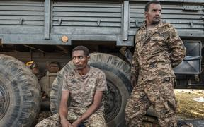 Ethiopian soldiers rest in front of the entrance to the 5th Battalion of the Northern Command of the Ethiopian Army in Dansha, Ethiopia, on November 25, 2020.