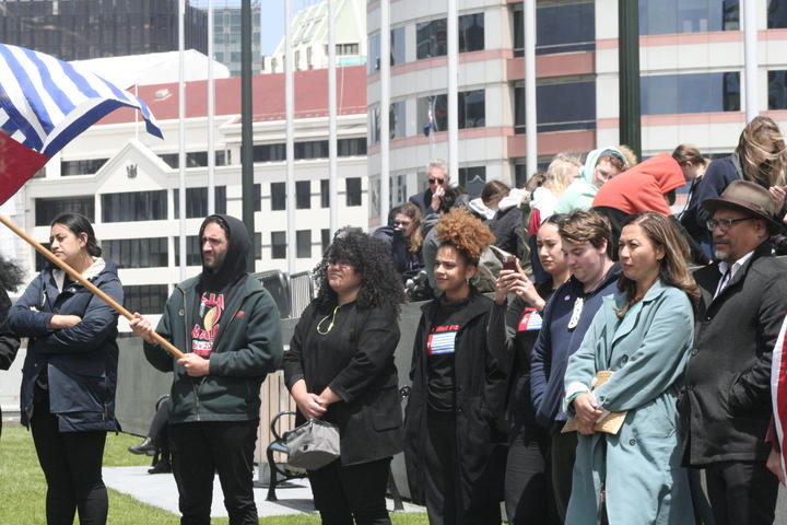 Green Party MPs Marama Davidson and Teanau Tuiono (far right) attend a demonstration at parliament to mark the 59th anniversary of the day West Papuans first raised their nationalist Morning Star flag. 1 December, 2020.