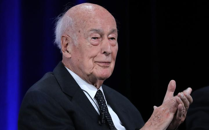 (FILES) In this file photo taken on June 20, 2019 Former French President Valery Giscard d'Estaing applauds at the conference of the 50th anniversary of the election of Georges Pompidou to the Presidency of the Republic