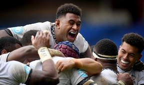 The Flying Fijians are all smiles after another try.