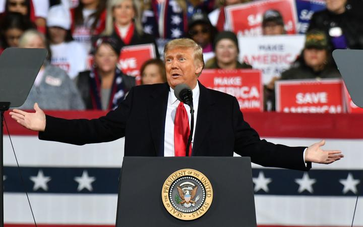US President Donald Trump addresses the crowd with the Republican National Committee hosts a Victory Rally with Senator David Perdue and Senator Kelly Loeffler in Valdosta, GA United States on December 5, 2020.