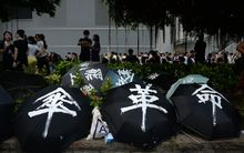 Demonstrators used umbrellas to shield themselves from pepper spray.