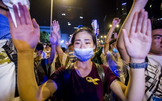 Pro-democracy demonstrators brought parts of central Hong Kong to a standstill.