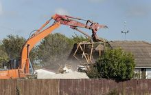 A house being demolished in Burwood following the February 2011 earthquake.