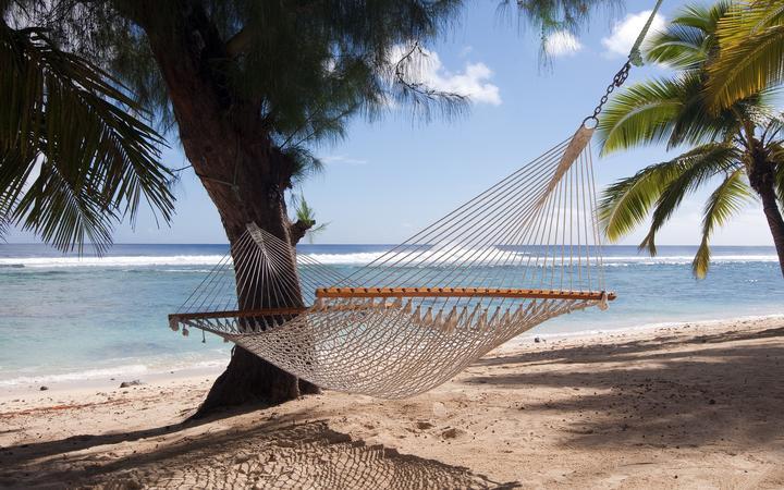 9921975 - hammock on a tropical beach, rarotonga, cook islands