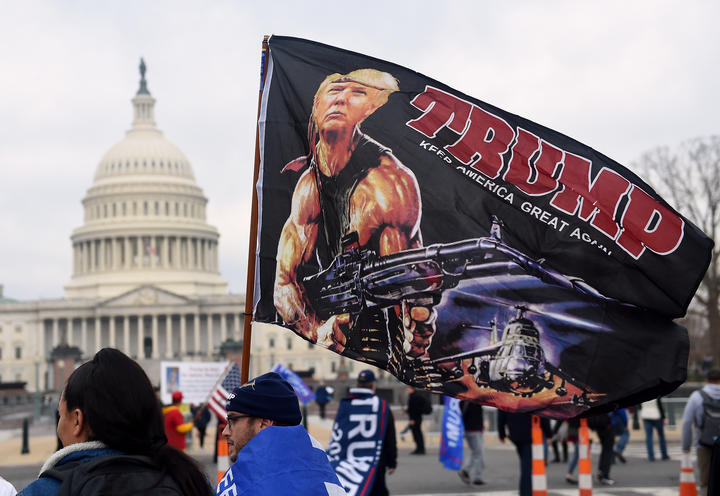 "Supporters of US President Donald Trump participate in the ""Million MAGA March""  to protest the outcome of the 2020 presidential election, in front of the US Capitol on December 12, 2020 in Washington, DC. (Photo by Olivier DOULIERY / AFP)"