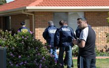 Federal police at a house in the Melbourne suburb of Seabrook.