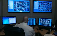 Security guard John Donaldson monitors CCTV footage from the region's trains.