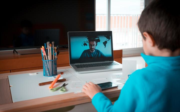 A child reading homework math during their online lessons at home, social distance during quarantine.  The concept of coronavirus isolation and online education due to infectious diseases.