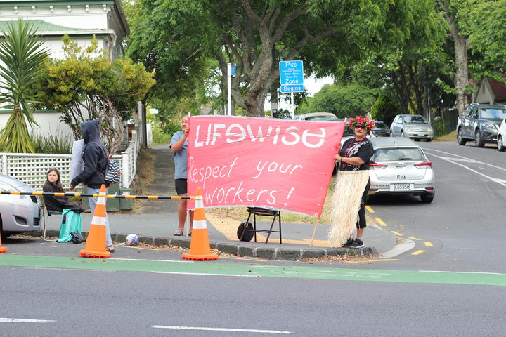"""Lifewise - respect your workers"" banner at the strike in Auckland"