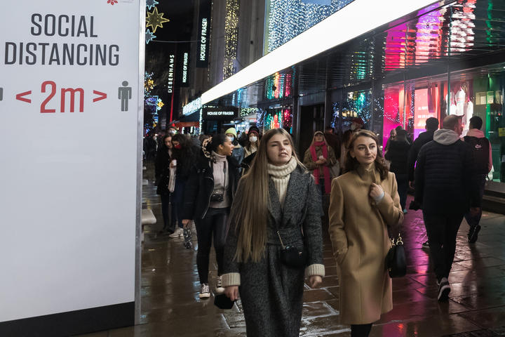 Shoppers walk along Oxford Street after new coronavirus restrictions were announced by British Prime Minister Boris Johnson.