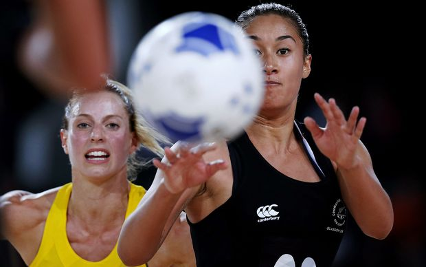 Maria Tutaia of New Zealand beats Laura Geitz of Australia to the ball. Glasgow 2014 Commonwealth Games.