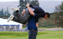 Europe's Rory McIlroy celebrates with a European Tour official. Ryder Cup. 2014.