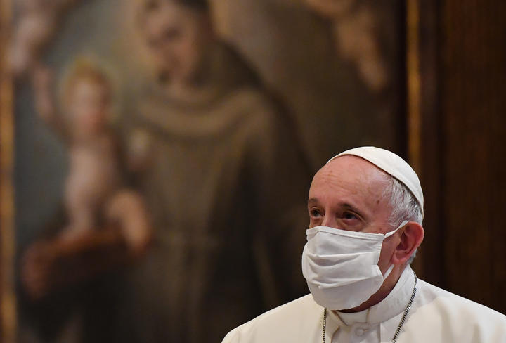 Pope Francis wears a protective face mask ahead of an inter-religious prayer service.