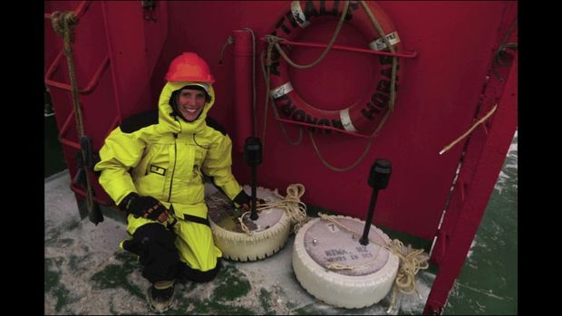 NIWA scientist Alison Kohout with two of the wave sensors, ready to be deployed onto the ice.