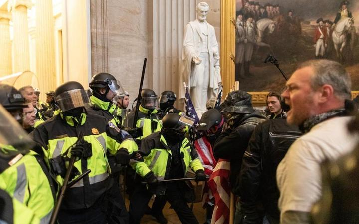Police intervenes in US President Donald Trump's supporters who breached security and entered the Capitol building in Washington D.C., United States on January 06, 2021.