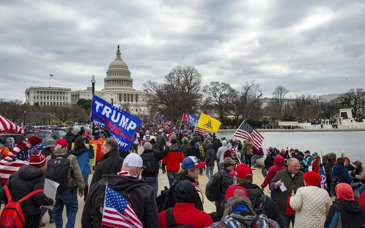 Supporters of US President Donald Trump march through the streets of the city as they make their way to the Capitol Building in Washington DC on January 6, 2021. -